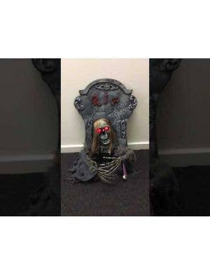 Animated Tombstone with Skeleton Decoration